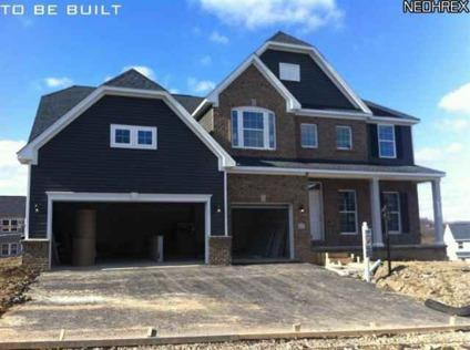 $329,990 With over 3,000 SF this home has it all! Partial Stone exterior with an
