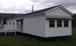 14x70' , 2 Bedroom, Full Bath, all New Double Pain Windows, New Siding, Metal Roof 4 years old, Carpeting throughout 4 years old. Large living room, open kitchen with snake bar and additional enclosed sunroom. All Electric Heat, New 200 amp Service
