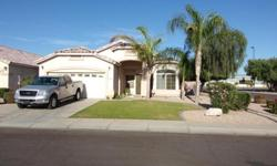 STANDARD SALE AND SELLER WILL CARRY PROPERTY. This beautiful 3 bedroom plus Den home is located in a great area of Gilbert close to shopping and entertainment. When you walk into the home it opens into a large formal living room and dining room with a