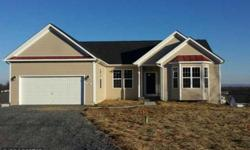 Open contemporary ranch design.large kit w/breakfast rm off of family room w/vaulted ceilings.