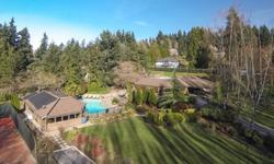 Every day is vacation at this 1.23 acre estate complete with pool, tennis court, multilevel deck & cabana/guest house with full kitchen, sauna, steam room, vaulted great room & covered patio with built-in BBQ . This gorgeous, sprawling rambler was