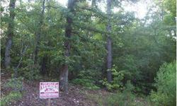 Prime Building Lot for Your Dream Cabin or Vacation Rental Property! See this 1.66 Acre Heavily Wooded Tract in the Northern Hills Addition of Hochatown-Listing originally posted at http