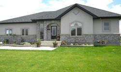 Custom Built 2 Year Old Bungalow Located in Desirable Waters Edge Community. Main Floor Feat