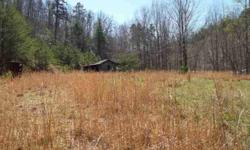 Here is a property ready for you to build on. Open land sits on a knoll overlooking the Mayo River. Approximately 2 acres open land with a small spring fed pond and barn. Rough road to the top of the property has building sites with views!There is an old