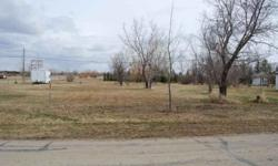 Nice flat large lot perfect for a new build home or modular. Inexpensive living in this town that is starting to see the effects of the oil boom. Electricity, water and sewer are within feet of the property. Nice quiet neighborhood. Listing originally