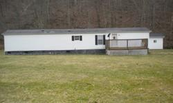 1998 Holly Park Mobile Home 14X70 2BDR, 2BA, excellent condition, new hardwood floors throughout, new paint, city water, also has well water outside, gasWith 13.5 acres 24X32 finished and insulated garage12X20 outbuilding